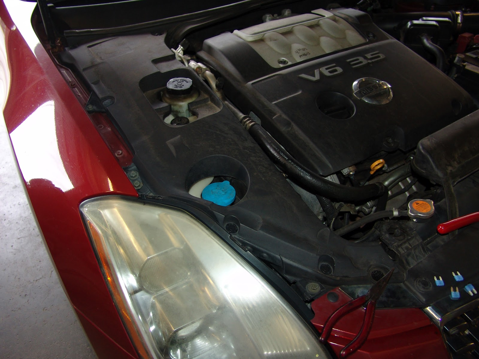 Where is the 350z tail light fuse located?